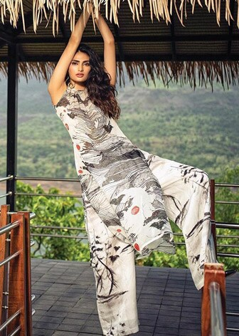 Ivory Westeros Wrath Sheer Tunic With Baggy Trousers by ATHIYA SHETTY WEARING MASABA-CELEBRITY CLOSET