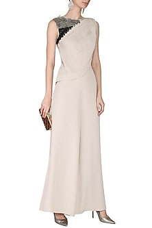 Ivory Pleated Tassels Jumpsuit by Aashna Behl