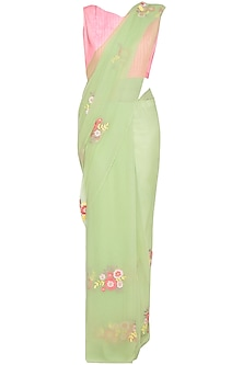 Pista green embroidered saree with pink blouse by Aharin India