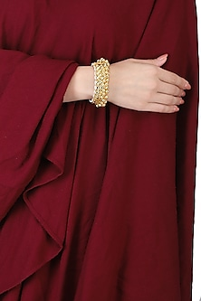 Gold plated kundan and gold beads bracelet by ANJALI JAIN