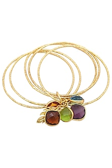 Set of 5 gold plated multi colored topaz stone bangles by ANJALI JAIN