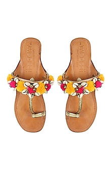 Nude kolhapuri flats with yellow and pink pompoms by Aprajita Toor