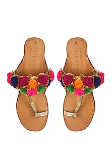 Nude kolhapuri flats with gotta flowers and multi coloured pompoms by Aprajita Toor