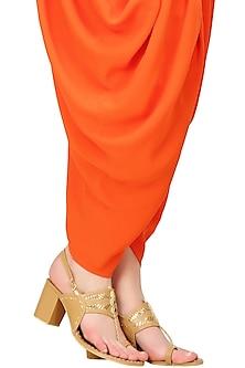 Nude block heels kolhapuri with golden trims by Aprajita Toor