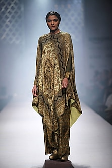 Pale and olive green printed cape with printed palazzos by Ashima Leena