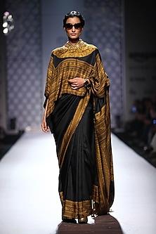 Black plain printed border saree with square embellished print blouse by Ashima Leena