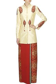 Ivory paisley printed mandarin collared jacket and red wrap around skirt set by Ashima Leena