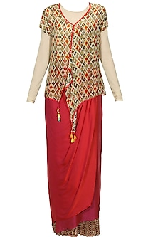Beige paisley printed top and red wrap around layered skirt set by Ashima Leena