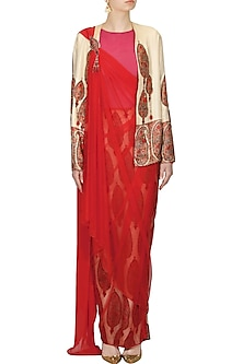 Ivory paisley applique work jacket, beige skirt and red saree wrap up set by Ashima Leena