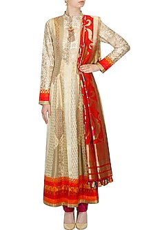 Gold and beige brocade textured flared anarkali set by Ashima Leena