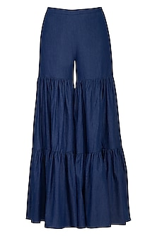 Blue washed denim sharara pants by Aruni