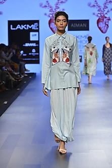 Powder blue pleated drape skirt by Aiman