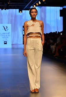 White neoprene high waisted trousers by Archana Rao