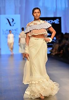 White ruffle border saree by Archana Rao