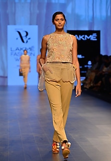 Nude neoprene pleated trousers by Archana Rao