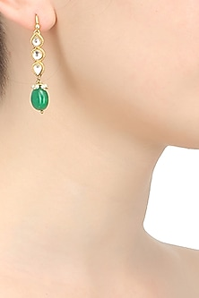 Gold finish kundan and green stone drop earrings by Art Karat