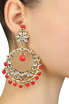 Gold Finish Kundan And Coral Beads Crescent Earrings by Art Karat