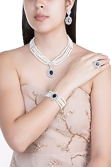 White Finish Faux Pearl, Diamond & Blue Stone Necklace Set With Bracelet & Ring by Aster