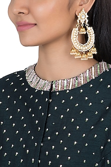 Gold plated faux kundan chandbali earrings by Aster