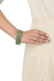 A Pair Of Gold Plated Round Bangle In Alloy Studded with Emerald Rectangular American Diamonds