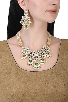 Gold plated kundan, green beads and pearl necklace set