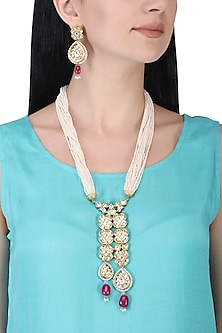 Gold plated kundan and red bead long necklace set by AURAA TRENDS