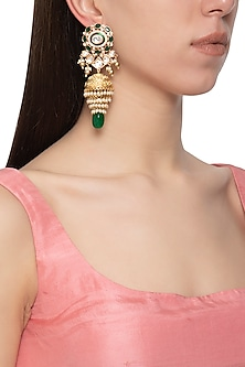Gold plated kundan and green stone jhumki earrings by Auraa Trends