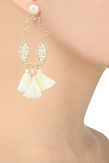 White tassel and pearls abstract motif earrings by Bansri