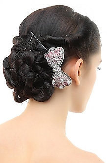 Set of 2 rhodium plated shades of pink stone bow haircomb