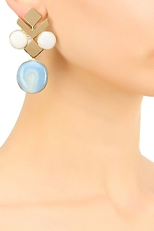 Gold plated white and blue glass cabochon with specs earrings