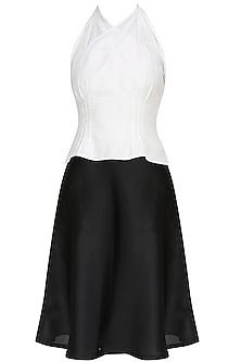 White draped halter top with black skirt
