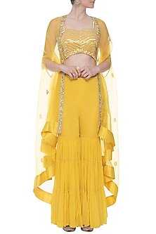 Yellow embroidered sharara set with cape by CHHAVVI AGGARWAL