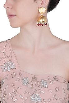 Gold plated red crystal jhumki earrings by Digna