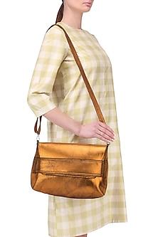 Orange metallic sling bag by Dhruv Kapoor