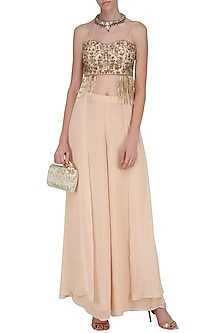 Blush Pink Embroidered Crop Top and Flared Pants by Dheeru and Nitika