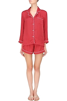 Red satin shirt and shorts set by Dandelion