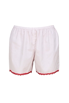 White and red satin camisole and shorts set by Dandelion