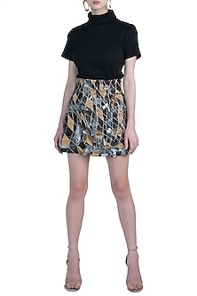 Black and gold crop top with skirt by Diya Rajvvir