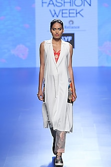 White Long Lab Coat, Orange Bralette And Grey Trouser Pants by Farah Sanjana