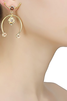 Gold finish horseshoe open earrings by Finura By Richa