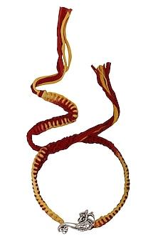 Lord Ganesha Brooch and Moli Thread Rakhi Set by FOURSEVEN