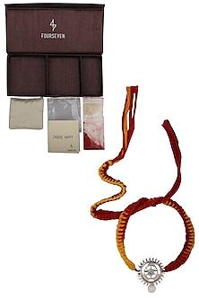 Sudarshan Chakra Brooch and Moli Thread Rakhi Set by FOURSEVEN