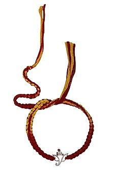 Lord Ganesha Pendant and Moli Thread Rakhi Set by FOURSEVEN