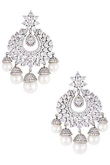 Rhodium plated diamond and pearl chandbali earrings by HEMA KHASTURI LABEL