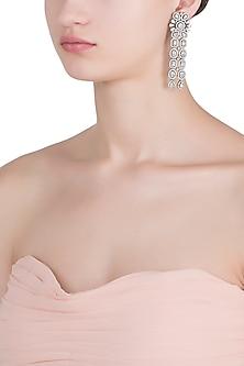 Rhodium plated diamond floral earrings by HEMA KHASTURI LABEL