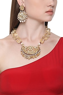 Gold Plated Kundan and Red Meena Pendant Necklace with Earrings by HEMA KHASTURI LABEL