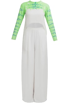 White sequined high low tunic and palazzo pants set by Huemn