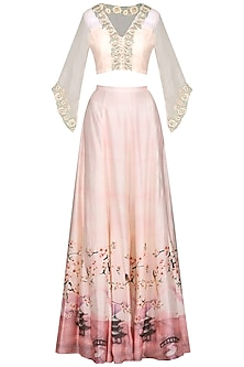Salmon pink embroidered cape with printed skirt and dupatta by Himani And Anjali Shah