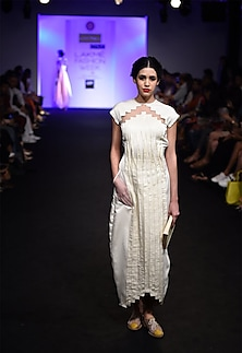 Pleated ivory long dress with organza pockets and back drop flap by I AM DESIGN