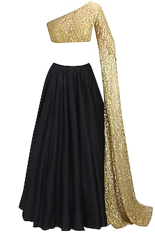 Black flared lehenga and nude embroidered lehenga set by Nikhil Thampi